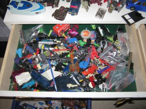 Drawer full of random G1 transformers accessories